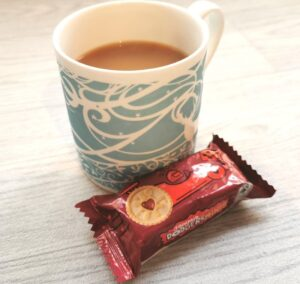 A mug of tea with a pack of mini Jammie Dodgers